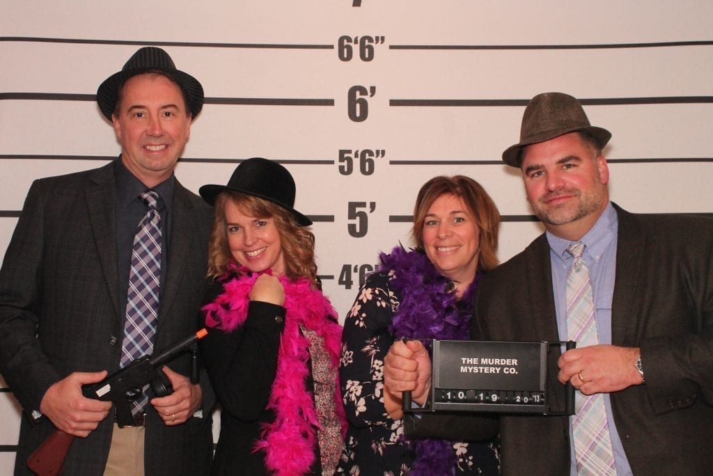 client group mugshot photo at a team bulilding event with The Murder Mystery Company
