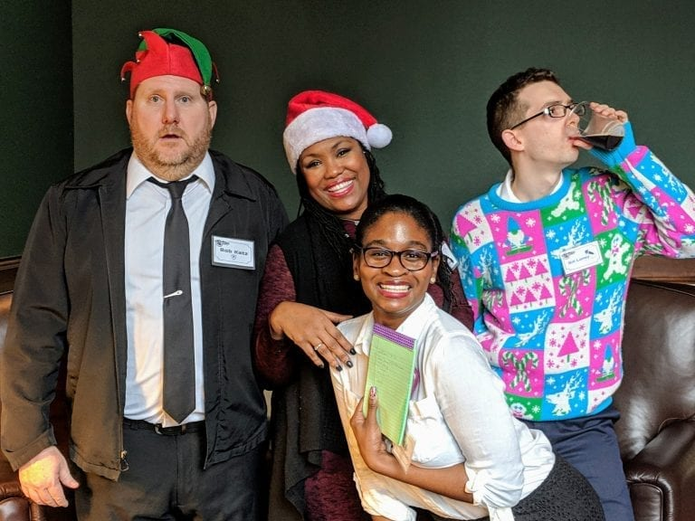 holiday murder mystery party clients posing for group photo