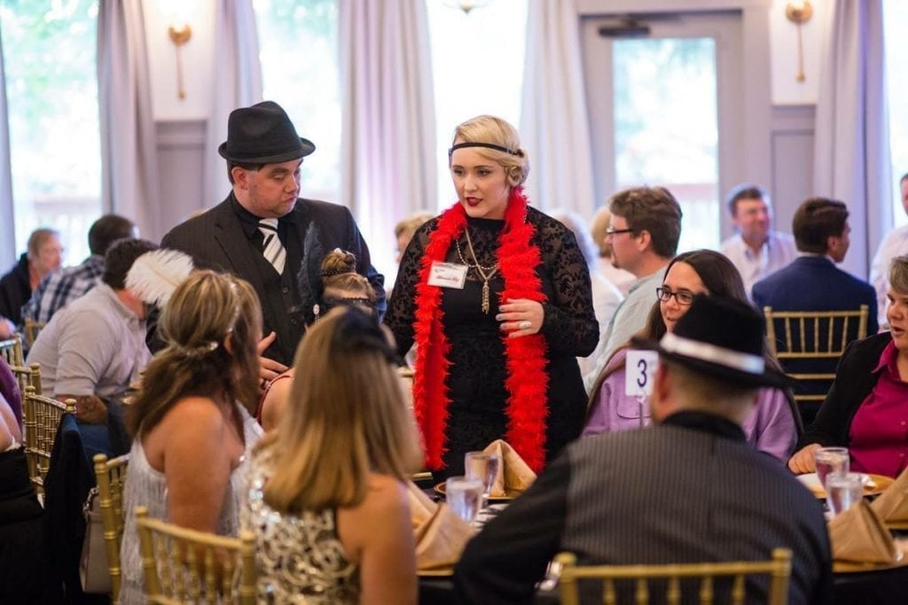 Murder Mystery Co actors interact with team building event clients.