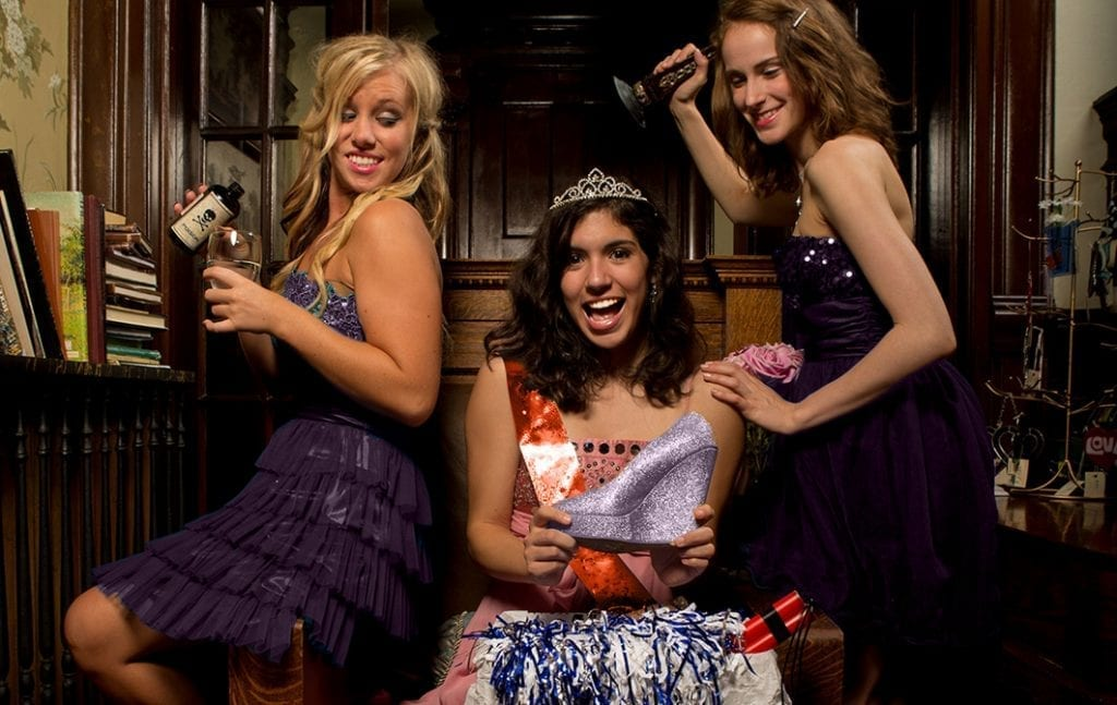 3 teenage girls celebrating at a murder mystery quinceanera.